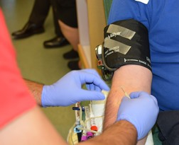 New Plymouth ID phlebotomist taking blood sample